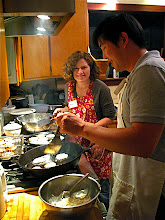 Photo: Amy and Derek frying daikon cakes 2