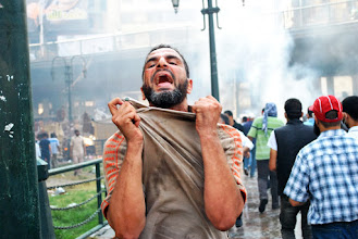 Photo: A man reacts to the break out of violence during Friday's 'Day of Rage' protest. Clashes between police and protesters broke out shortly after the noon prayer, leading to at least 95 people being killed. Cairo, EGYPT - 16/8/2013. Credit: Ali Mustafa/SIPA Press