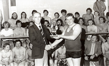 Photo: Tom Lynch is presented with the Club Spearfishing Trophy by sponsor Tony Hackett of Alpha Travel
