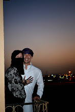 Photo: The couple wears the traditional clothing most people in Kuwait wear every day and Hilsinger had henna tattoos done a day earlier.