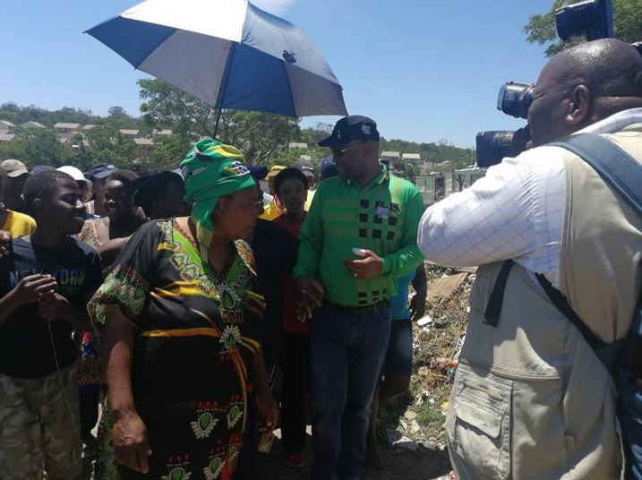 Nathi Mthethwa with Scenary Park community members during his door-to-door campaign for voter registration.