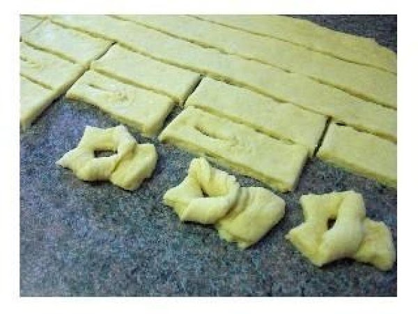 Roll out half the dough at a time into a large rectangle.Use a fancy...