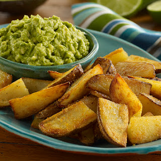 Oven Baked Potato Wedges with Guacamole.