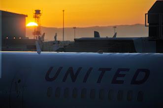 Photo: The sun sets as we prepare to board. Bye-bye Hawaii.