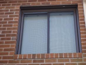 Photo: Brown vinyl sliding window