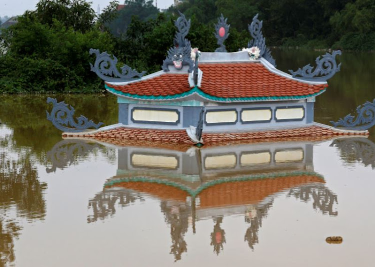 A submerged temple is seen in a flooded village after a tropical depression in Hanoi, Vietnam October 13, 2017.