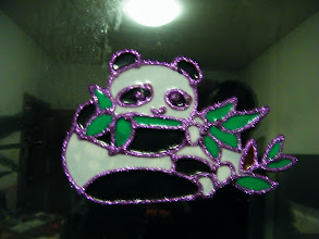 Photo: warrenzh 朱楚甲's works: color embedding in a panda sculpture, art work made in year end celebrating, in mom's accompany. mom put it on windows like a decoration. here I shot it while dad, benzrad, watched.