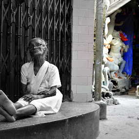 Our colorful present does exist for their black & white past  by Santanu Goswami - City,  Street & Park  Street Scenes ( story, mother, kolkata, kumortuli, durgapuja )