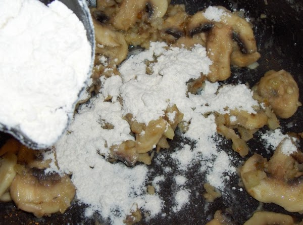 """Sprinkle the flour over the top, stirring continuously. It will tend to """"seize up""""..."""