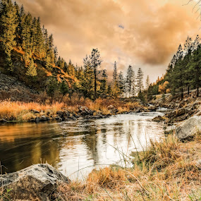 The Salmon River Sunset by Evan Jones - Landscapes Travel ( calm, shore, pines, reflection, smooth, peak, rocky, valley, remote, landscape, decor, water's, idaho, tranquil, camp, mountains, sky, nature, autumn, fine, water, clouds, wild, edge, art, steep, forest, scenic, woods, wilderness, blue, sunset, fall, outdoors, vista, trees, salmon, western, bar, natural, evergreen, west, river )