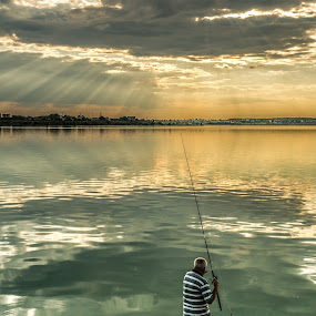 Fishing at dawn by Sabin Malisevschi - Landscapes Sunsets & Sunrises ( clouds, fish, sunset, fishing, fisherman, landscape, rays, sun )