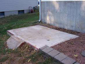 Photo: Here is the concrete pad where our old, metal shed used to be. Dan helped me disassemble it and get the concrete pad cleaned and ready for the new shed! I'm not sure what I'll do with the concrete ramp that leads onto the pad. I may just leave it there...maybe add some flowers around it or something.