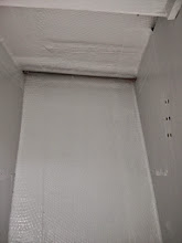 Photo: Large haning locker on starboard, opposite head, with a frewh coat of white paint