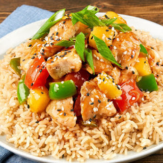Healthy Takeout Sweet and Sour Chicken with brown rice and green bell pepper