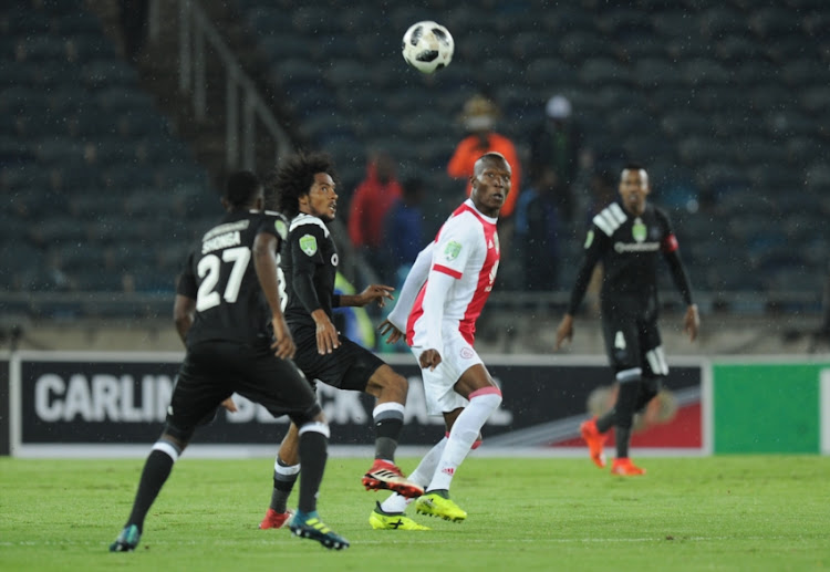 Issa Sarr and Justin Shonga of pirates in action with Tendai Ndoro of Ajax during the Nedbank Cup Last 32 match between Orlando Pirates and Ajax Cape Town at Orlando Stadium on February 10, 2018 in Johannesburg, South Africa.