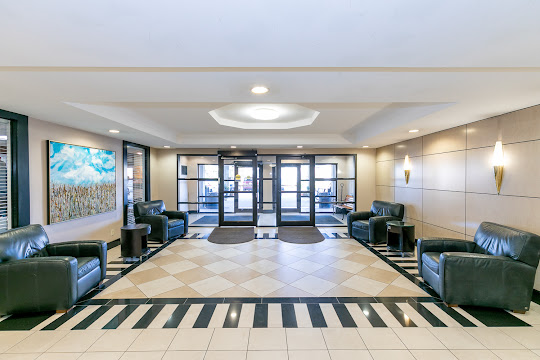 Indoor clubhouse seating area with tile flooring and comfortable seating