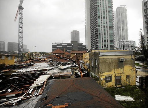 Destroyed roofs at a residential area are seen as Hurricane Irma passes south Florida, in Miami, US, on September 10 2017. Picture: REUTERS