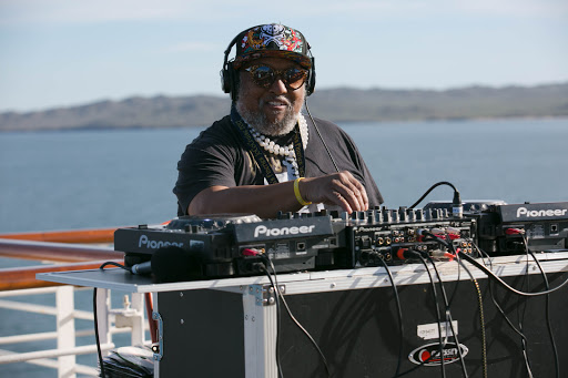 DJ on the aft deck.jpg - A DJ revved up the afternoon party on the aft deck of Westerdam.