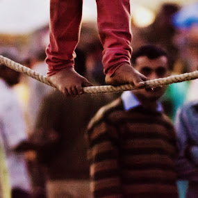Walking on rope by Akash Deep - News & Events World Events ( holi fair, rope walking, poverty, walking on arope, young girl, fair, sujanpur fair )