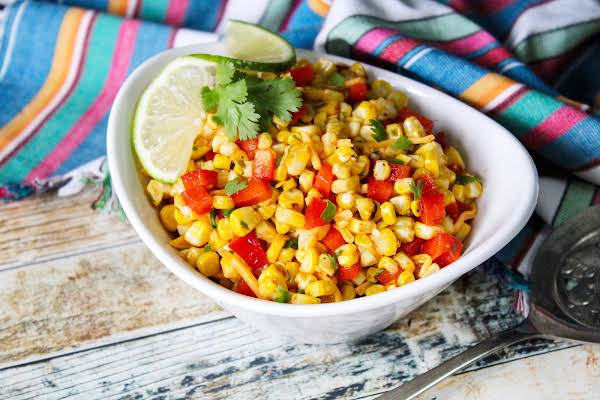 A Bowl Of Grilled Corn And Fresh Pepper Salad.