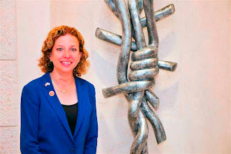 Photo: During her tour of the Sarah Wetsman Davidson Hospital Tower at the Hadassah Medical Center-Ein Kerem, in the lobby adjacent to the David and Fela Shapell Family Gateway to Health, Rep. Debbie Wasserman Schultz (D-FL) paused before the memorial to the Shoah, a gift of Rochelle, Benjamin and Irwin Shapell that honors the memory of their grandparents who perished in the Holocaust.
