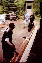Photo: Staining soffett boards. 1998