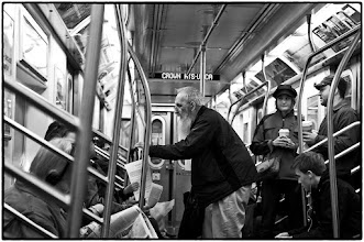 Photo: This man was passing out information and telling people about it. I have no idea what it was about but the look of the woman behind him might lead one to believe that the story was questionable. Just another day in New York City. www.leannestaples.com #streetphotography