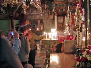 Photo: Devotional candles are lit at the site.
