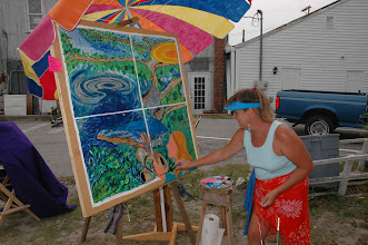 Photo: Beaufort artist, Jenifer Crowell, puts the finishing touches on her mural