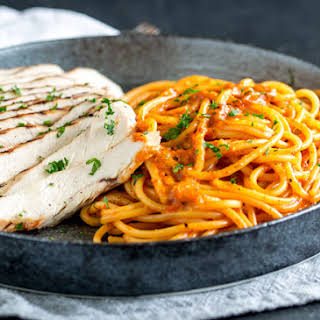 Grilled Chicken Pasta with Roasted Pepper Cream Sauce.