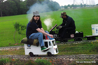 Photo: Michael Scherpenberg on his Personal Rail Vehicle and Paul King at Cabin Creek.   HALS - SWLS 2009-0523