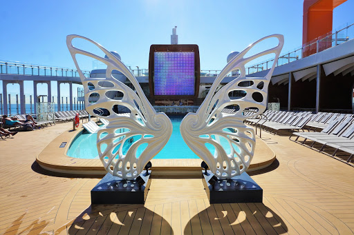 5-1.jpg - The Resort Deck on Deck 14 transforms what it means to be a cruise ship pool. This trendy location feels like it belongs in a 5 Star, Miami Beach hotel.