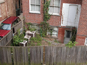 Photo: September 2003 - Month 1: Back yard with AC units, poison ivy, painted windows, lower level floodgate (door) and other nasty stuff. Great fence!