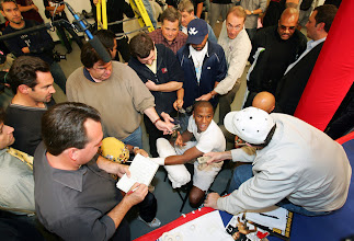 Photo: LAS VEGAS - NOVEMBER 28:  Boxer Floyd Mayweather Jr. is interviewed by reporters as his hands are taped before a workout November 28, 2007 in Las Vegas, Nevada. Mayweather will fight Ricky Hatton for the WBC welterweight championship in Las Vegas on December 8.  (Photo by Ethan Miller/Getty Images)