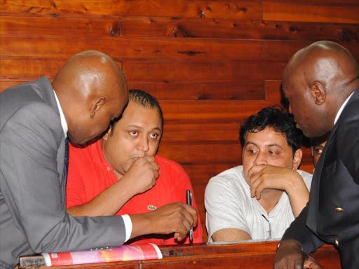 Baktash Akasha and Ibrahim Akasha with lawyers Gikandi Nguibuini (left) and Cliff Ombeta at Mombasa law court, 2014.