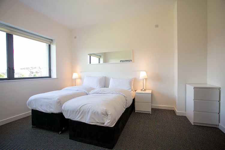 Bedroom at IFSC Mayor Street apartment