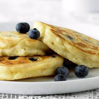 Fluffy Pancakes With Blueberries And Maple Syrup.