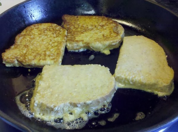 Cook on griddle brushed with butter until browned on each side. Remove to plate...