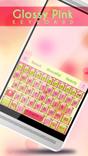 光沢のあるピンクのキーボード