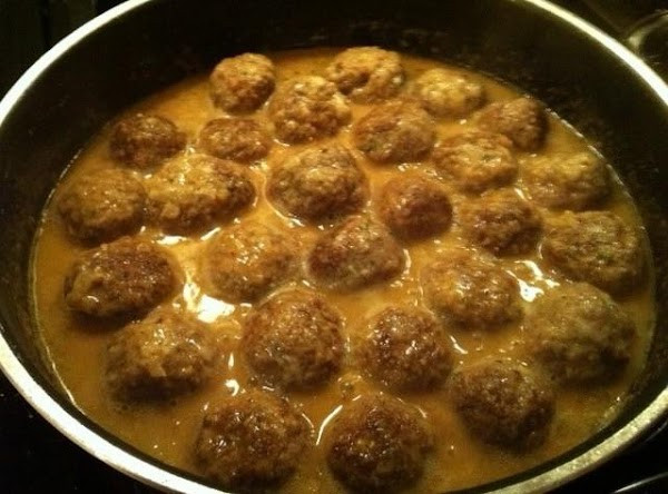 Nestle meatballs into skillet and bring to a simmer. Cover, and reduce heat to...