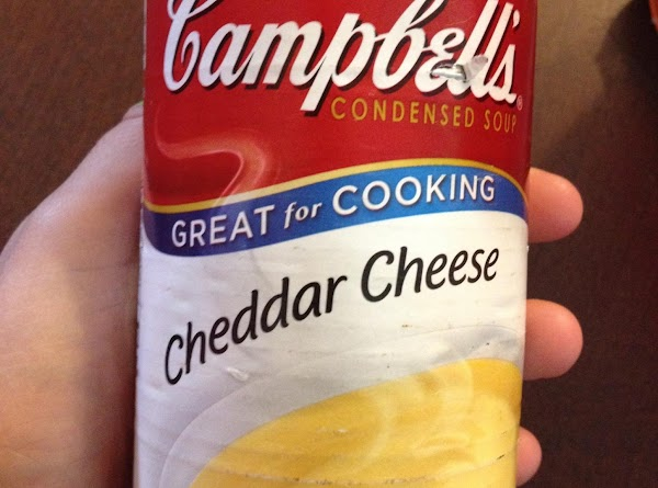 A can of Campbell's cheddar cheese soup.