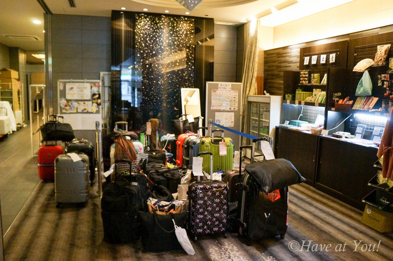 Village Kyoto lobby filled with guest luggage
