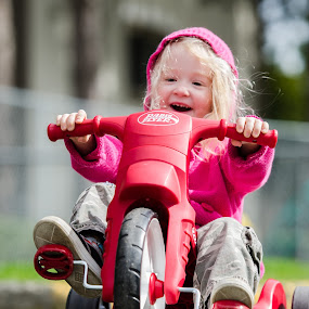 The Smile by Scott Hemenway - Babies & Children Children Candids ( girls, b&w, big wheels, black and white, nikon 70-20 2.8 vr ii, black & white, candid, road, fun, spring, sun, kid, playing, child, nikon d000, smile, hair )