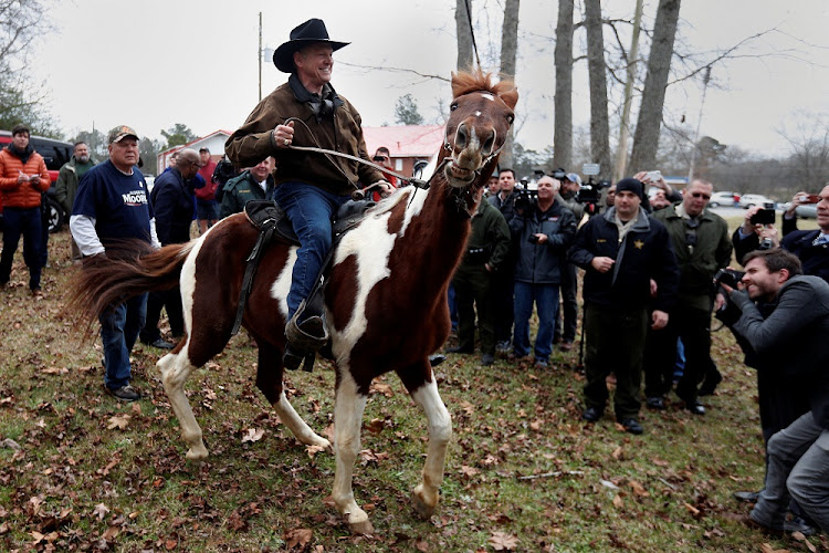 Republican Senate candidate Roy Moore departs on horseback after he cast his ballot in Gallant, Alabama, the US, on December 12 2017. Picture: REUTERS