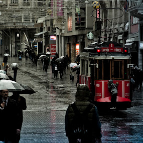 Young stowaway on tram wagon by Giorgos Latsouris - City,  Street & Park  Historic Districts ( child, tram, istanbul, rain, istiklal,  )
