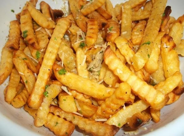 Once fries are golden, sprinkle with kosher salt & place in a large bowl,...