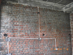 Photo: Electric Conduits, GF Front Bedroom, Bedside wall