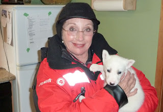 Photo: Benay with a baby sled dog