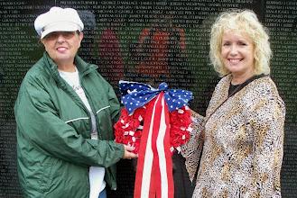 Photo: Rosie Garlitz and friend  set a wreath at the Wall