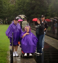 Photo: A little rain but our Prez Nelson Kelly and his wife were ready for it